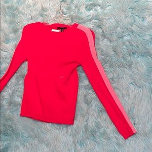 A red and pink sweater